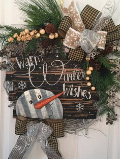 Winter Wreath Front Door Front Door Winter Wreath Snowman Love this cute winter wreath for the front porch, door or patio. Adorable seasonal decor. Perfect for after Christmas. #wreath #winter #afflink