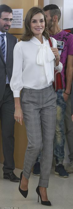 Queen Letizia, 45, looked sharp as she arrived at the opening of the Vocational Training Courses held at Teruel's Segundo de Chomón secondary school in Spain's eastern Aragon region.