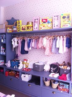 Children's shop display. Wallpapered storage. Les P'tits Boudoirs boutique, Nice, France.