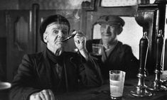 "Two men drinking at a Dublin bar.  Photograph: Bert Hardy/Hulton Archive/Getty Images.  Colm Tóibín on Joyce's Dublin: city of dreamers and chancers.  One hundred and eight years ago today James Joyce and Nora Barnacle went out walking together for the first time. ""Bloomsday"", the day on which the novel Ulysses takes place, happens also on 16 June 1904. Hidden aspects of his own life nourished the narrative for Joyce."