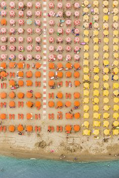 Aerial Adria by Bernhard Lang | iGNANT.de | Photographer Bernhard Lang, whose work we featured previously went on vacation at a seaside resort in Adria, Italy a few years ago where he was struck by the perfectly uniform arrangements of colored umbrellas used by each hotel. Last month he returned, this time by air, and shot for several hours on the coastline between Ravenna and Rimini.