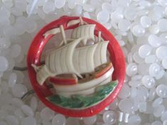 vintage hair barrette red  celluloid sailing ship. Rare