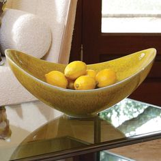 This photo is supposed to be of Global Views' Citron Swoop Bowl, but I am saving it for the picture of the gorgeous white nubby boucle upholstered chair and bolster.