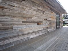 Reclaimed weathered wood siding.