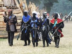 This is it - the only good picture of me at the Conquest of Mythodea 2009 (I am the one in red) - together with my fellow LARP-friends from the Qu'. me at Conquest 2009 Conquest Of Mythodea, Horde, Larp, Warfare, Cool Pictures, Medieval, Fanart, Internet, Fandoms