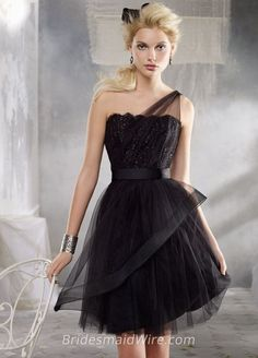 Black tulle short bridesmaid dress with horsehair detailing on skirt. Carolina Chantilly lace bodice with a one shoulder sheer tulle overlay. Grosgrain ribbon at natural waist.