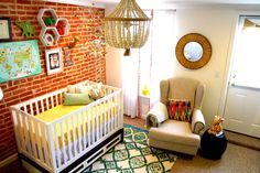 Eclectic Nursery with Pops of Color - can we just talk about this @anthropologie rug? Wow!