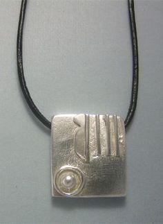 talismanes amuletos y símbolos | colgante sello maya mano Kin Manik