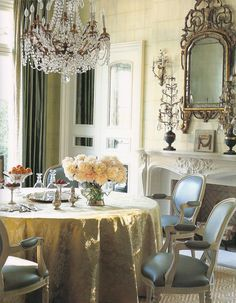 Elegance at it's finest. Beautiful dining room. Design by Suzanne Kasler.