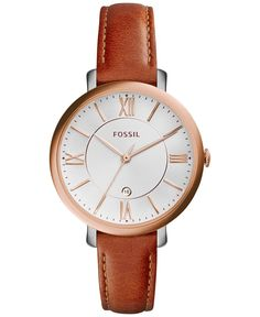 With smooth leather and a rosy case, this Jacqueline watch from Fossil brings a rich presence to your look. | Dark brown leather strap | Round stainless steel case, 36mm, rose gold-tone bezel and crow