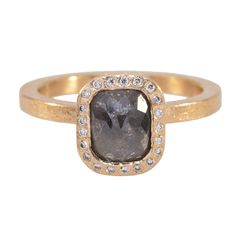 TRDR481-RG-SQ67: The one of a kind ring centers a rectangular shaped rose cut dark gray diamond with a diamond halo set in 18K rose gold, finger size 6.25 (resize possible). Diamond: One dark gray raw