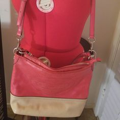 Coach Hamptons Coral Convertible Shoulder Bag Coach Hamptons Coral & Beige Convertible Shoulder Bag. Gently used. Inside of bag needs minor cleaning an strap has minor wear an unnoticeable. Other than that no wear. Coach Bags Shoulder Bags