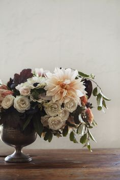 Low centerpiece with cafe au lait dahlias, spray roses, and anemones.