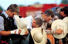 cowboys praying before a rodeo... yes.