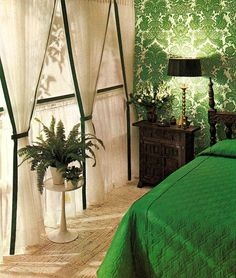 All kinds of layers of style slapping is happening with this room right now... green white room