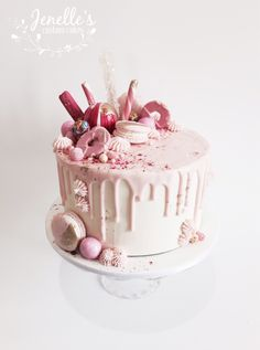 Pink and white drip cake. By Jenelle's Custom Cakes.