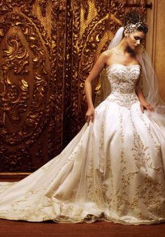 ivory-wedding-dresses. Normally I don't like brocade, but I do like the kind of ivory or vinery going up it.