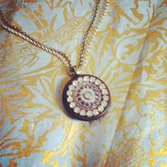 dwallacedesigns- 1800's vintage mother of pearl button decorated with antique crystals.
