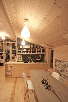 Interior of DublDom60 - natural color of the wood in the decoration and furniture combined with black wooden background.