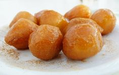Loukoumades, one of my favourite Greek pastries, are sweet fritters (similar to doughnuts) that are deep fried till golden brown and served warm with a honey syrup, sprinkled with cinnamon and nuts. Greek Desserts, Greek Recipes, Honey Recipes, Honey Puffs, Greek Pastries, Honey Syrup, Lemon Syrup, Fritters, Dry Yeast