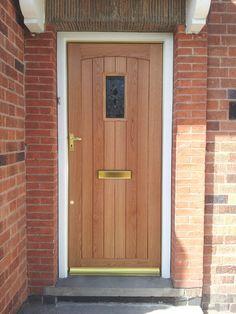 Oak Cottage Door Complimented By Brass Door Furniture