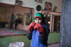 Photos show Afghan women who are boxing, rapping, and breaking all manner of tradition