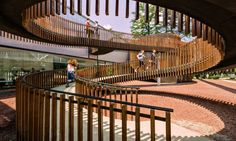 The Mediathek library was built in the center of a park to give locals a peaceful, family-friendly community center in the heavy urban area surrounded by housing blocks and industrial zones.