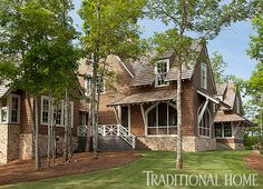 The results of this stunning lakeside home in Alabama is a design collaboration by architect Bobby McAlpine and designer Susan Ferrier. Traditional Home Magazine, Haus Am See, Shingle Style Homes, Rustic Photography, Rustic Fireplaces, Traditional House Plans, Traditional Homes, Rustic Design, Rustic Style