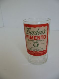 VINTAGE BORDENS PIMENTO CHEESE SPREAD SWANKY SWIG JUICE GLASS Mom use to buy this and we had some juice glasses.