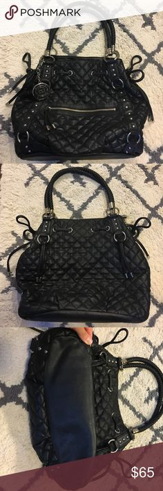 bebe Quilted Purse Stunning bebe quilted black purse with front zipper pocket and two small side pockets on the inside. Very slight signs of wearing on the very front of bag - material is peeling in the middle/front, side bows and front leather zipper handle wearing of material, metal rings on front and back handle have wearing and a few stretches. bebe Bags Shoulder Bags