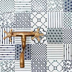 Blue and white morrocan tiles with gold tap hardware