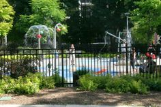 Lovely tiny playground with splash pad off Cawthra Park, behind the 519 Community Centre in Church-Wellesley Village (Toronto Urban Strolls: Church Street Murals Project in Toronto)