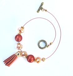 This 16-inch fabulous leather tassel choker necklace is all about glitz, glamour, and glitter – thanks to brilliant flame-colored glass rounds, twinkling faceted glass beads, and gold accents. http://etsy.me/2H0e4nc #jewelrybyscotti #handmadejewelry #etsyshop