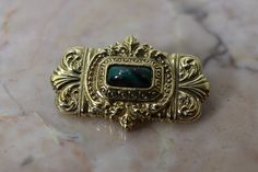 Vintage decorative goldtone brooch with green by TheHavenFinds