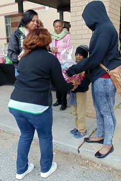 Georgia Alpha Kappa Alpha chapter hands out Thanksgiving turkeys to kids in need.