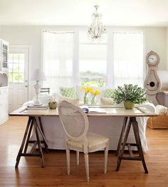With flea market treasures, repurpose is the word to keep in mind. A barn door set on two old sawhorses becomes a desk in this living room! http://www.bhg.com/decorating/decorating-style/flea-market/ideas-for-flea-market-finds/?socsrc=bhgpin051015doortable&page=16