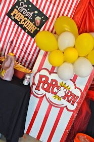 Love the giant popcorn box with balloons. Easy to make with big impact. Could do cotton candy too.
