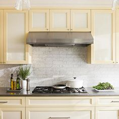Add some grandeur to your kitchen with marble tile! More backplashes here: http://www.bhg.com/kitchen/backsplash/subway-tile-backsplash/?socsrc=bhgpin072014addsomegrandeur&page=11