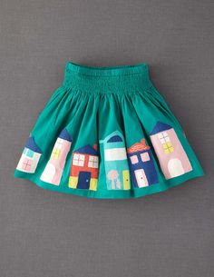 Appliqué Skirt. (from Mini Boden).  Applique is such an art, and I love the bright teal color and the charm of those houses... Wish this came in my size!!!