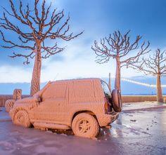 Ice covers a car near Lake Geneva near Versoix, Switzerland.