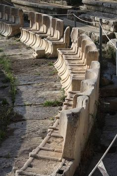 A row of the special stone seats from the front rows of the Theatre of Dionysos, on the slopes of the acropolis of Athens. Second half of the century BCE. The theatre was orginally constructed in. Greece Architecture, Theatre Architecture, Ancient Greek Architecture, Gothic Architecture, Ancient Ruins, Ancient Rome, Ancient Greece, Ancient History, Mayan Ruins