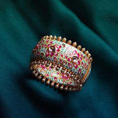 Style your ethnic look with this meticulously embellished meenakari bangle by Aster. Shop the piece exclusively at Pernia's Pop-Up Shop. We ship worldwide! To shop WhatsApp us on . Antique Jewellery Designs, Fancy Jewellery, Stylish Jewelry, Indian Bridal Jewelry Sets, Bridal Bangles, Gold Bangles Design, Hand Jewelry, Jewelry Design Earrings, Ethnic