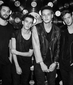 The 1975 are an English alternative/indie rock band based in Manchester. The group consists of Matthew Healy (vocals, guitar), Adam Hann (guitar), George Daniel (drums), and Ross MacDonald. Genre: Indie pop, alternative rock, pop rock, indie rock, nu gaze