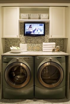 washing machine. check. dryer. check. awesomely placed tv so mom can just get the laundry done without having to haul it all to the living room first. double check.