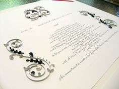 Quilled wedding certificate with green and gray.