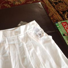 Beautiful lacoste summer skirt with pockets. Pleated and flattering Lacoste Skirts