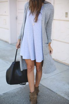 A neutral cardigan can be worn a variety of ways. Try it with skinny jeans and boots or over a flowy dress for a romantic feel.