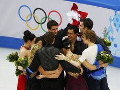 Canada's figure skating team celebrate after the flower ceremony at the Sochi 2014 Winter Olympics