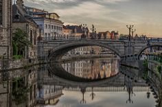 St Michiels bridge, Gent (urbanexpl0rer) Tags: gent belgium architecture oldcity bridge cityscape city historicalcity water reflection waterreflections canal canalhouses morning nopeople