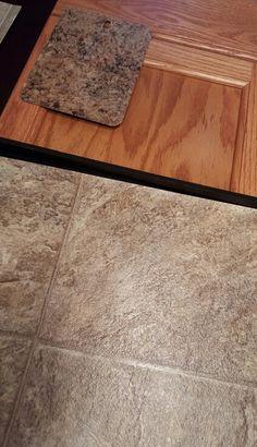 Kitchen - oak cabinets, vinyl flooring, laminate countertops